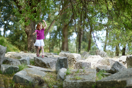 aesculapius: Little girl sightseeing historical ruins of Asclepieion