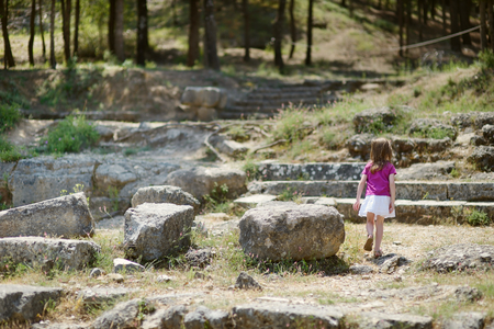 hippocrates: Little girl sightseeing historical ruins of Asclepieion