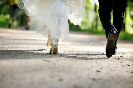 black couple wedding: Bride and groom legs walking away Stock Photo