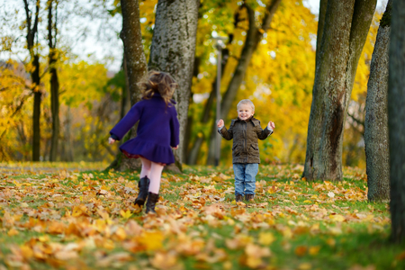 caucasian children: Children playing on beautiful autumn day Stock Photo
