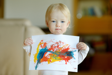 proudly: Little toddler girl displaying her picture proudly Stock Photo