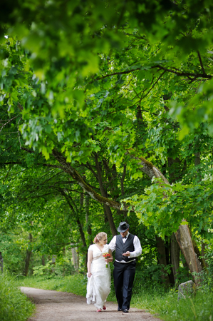 Beautiful bride and groom in a park photo