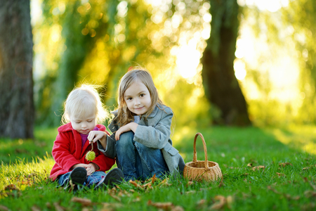 september 2: Two little sisters playing outside on a beautiful autumn day