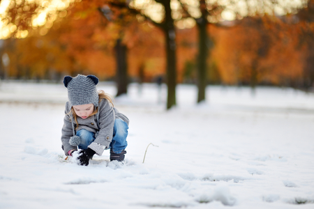 winter day: Little girl having fun on winter day in a city