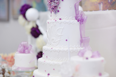 White wedding cake decorated with sugar purple flowers stock photo stock photo white wedding cake decorated with sugar purple flowers mightylinksfo
