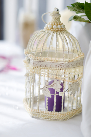 white bird: Fancy white bird cage as a wedding decoration