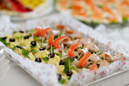 fingerfood: Plates with assorted snacks on an event party