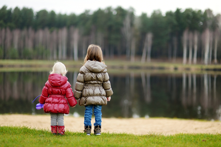 september 2: Two little sisters enjoying the view together on late autumn Stock Photo