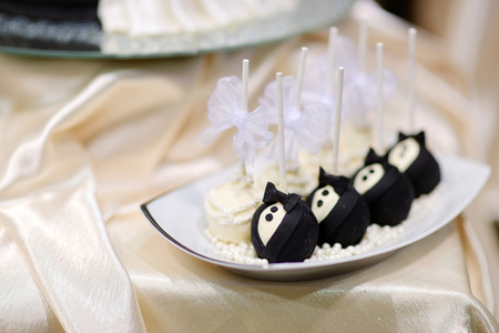 pops: Bride and groom cake pops on a plate Stock Photo