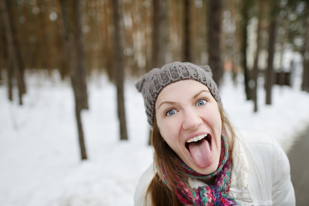 Young funny woman being silly on winter Stock fotó