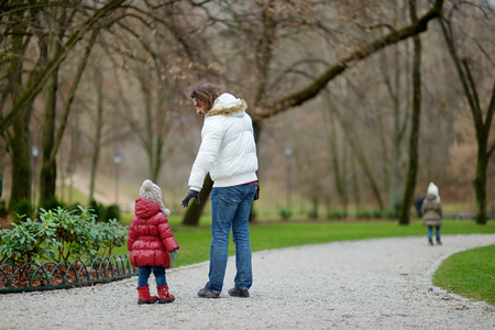 september 2: Young father and his kids in autumn park