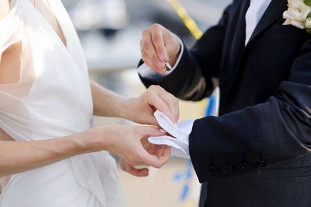 cufflinks: A bride helping her groom with his cufflinks