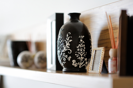 contemporary interior: Vase closeup in nicely decorated living room Stock Photo