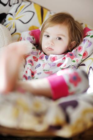 naptime: Little sad toddler girl in pajamas on sunny morning