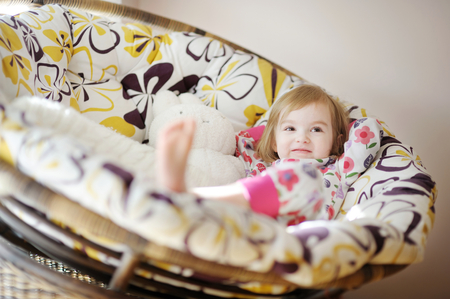 naptime: Little toddler girl in pajamas on sunny morning