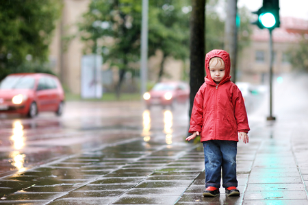 rainy day: Adorable toddler girl at rainy day in autumn