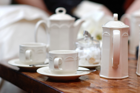 White fancy cups and teapot set Stock Photo