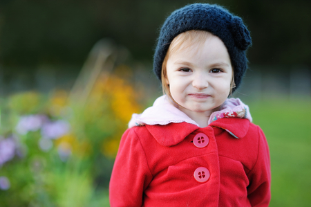 Adorable toddler in late autumn park
