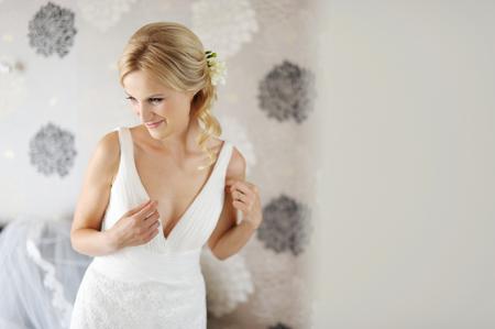 debutante: The beautiful bride in an interior