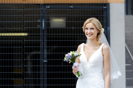 debutante: The beautiful bride smiling outdoors Stock Photo