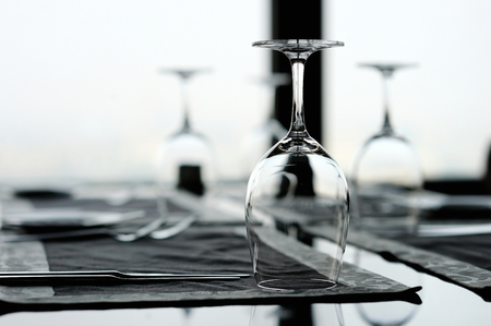 restaurant setting: Three wine glasses on a table