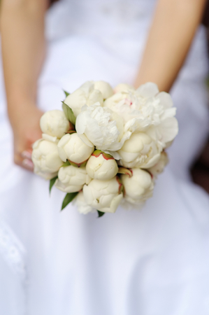 Bride holding beautiful peonies wedding bouquet Stock Photo