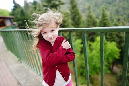 very windy: Cute little girl on a very windy day outdoors