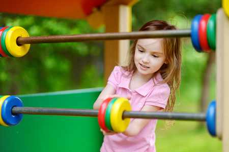 on playground: Little girl having fun at a playground Stock Photo