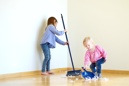 clean house: Two cute girls helping her mom to clean up