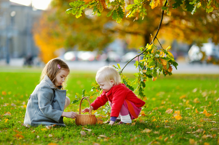 crafting: Little girls gathering acorns for crafting and playing