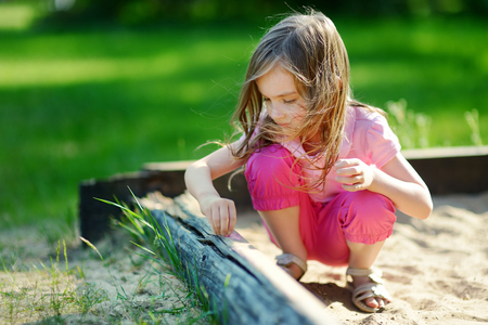 sandbox: Adorable little girl playing in a sandbox