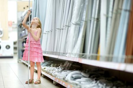 houseware: Adorable little girl in a houseware store
