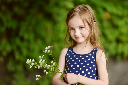 six years: Adorable six years old girl on beautiful sunny day at summer Stock Photo