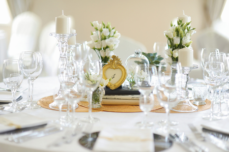 wedding table: Beautiful table set for an event party or wedding reception Stock Photo