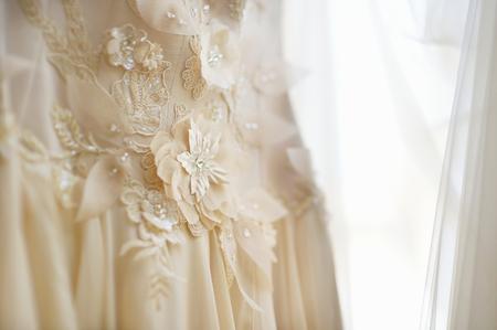 wedding decor: Beautiful wedding dress decoration close up