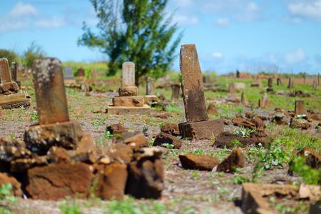 headstones: Very old chinese grave headstones abandoned near Glass Beach in Kauai Stock Photo