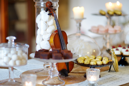 ot: Beautiful desserts, sweets and candy table at wedding reception ot other event