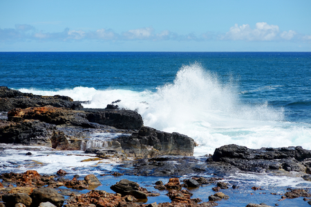 waves crashing: Ocean waves crashing on rocks, Kauai, Hawaii
