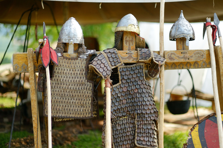 dub: Leather medieval armor, metal helmets and spears Stock Photo