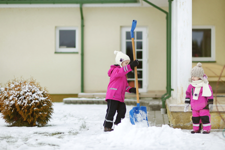 golden shovel: Two little sisters having fun on white and snowy winter day