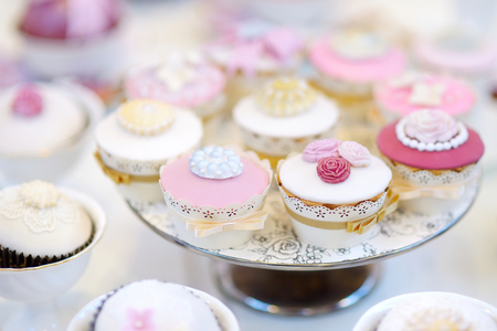 sugarcraft: Delicious colorful cupcakes for wedding reception or other event party Stock Photo
