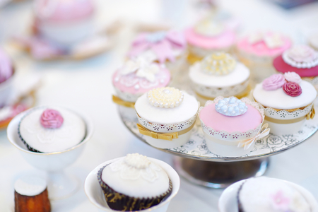 Delicious colorful cupcakes for wedding reception or other event party