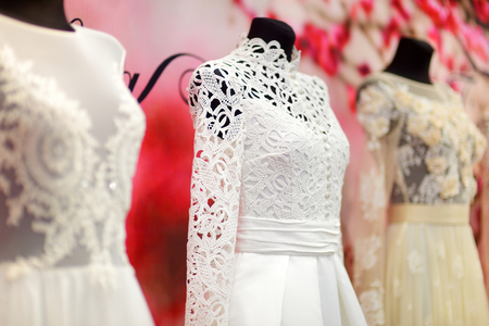 woman in red dress: Beautiful wedding dresses on a mannequins