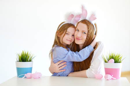 bunny ears: Adorable little girl and her mother wearing bunny ears on Easter day