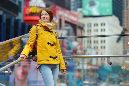 times square new york: Beautiful young woman sightseeing at Times Square, New York