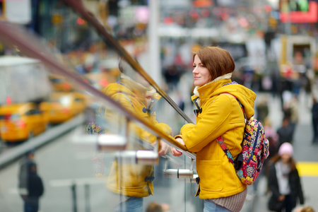 time's: Beautiful young woman sightseeing at Times Square, New York
