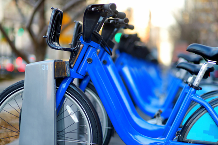 bike parking: Row of city bikes for rent at docking stations in New York, USA Stock Photo