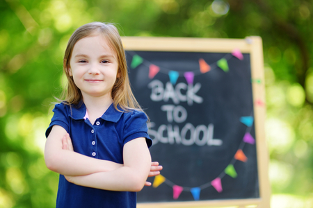 schoolgirl: Adorable little schoolgirl feeling very excited about going back to school Stock Photo