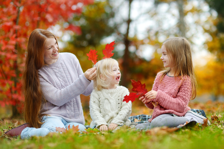 Happy family having fun on beautiful autumn day