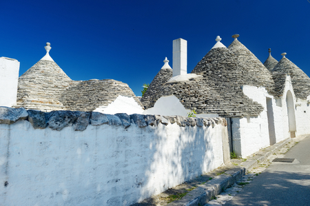 centres: Traditional trulli houses in Alberobello, Italy